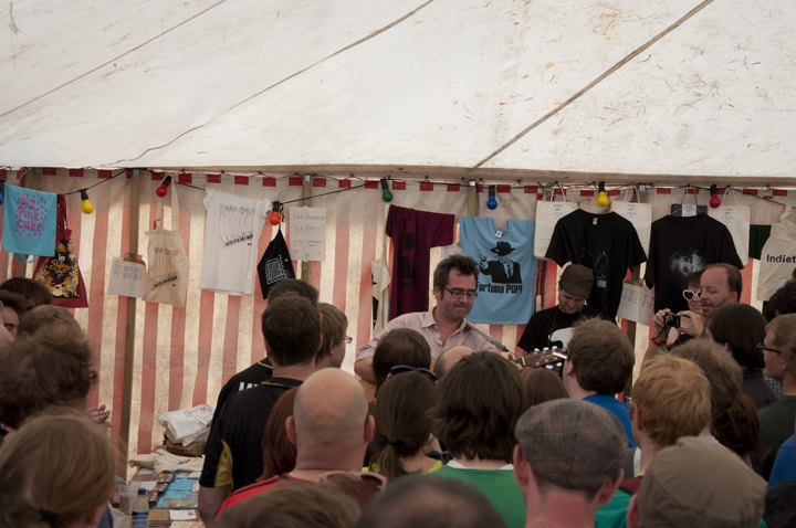 Later on, in the merchandise tent: Guerilla gig time!